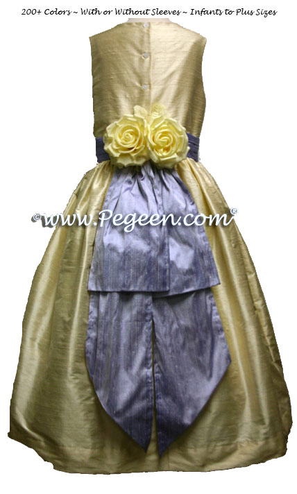 Lilac and buttercream silk flower girl dresses with yellow back flowers