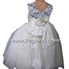 Flower Girl Dresses with beaded and sequined aloncon lace in black and ivory with layers and layers of tulle