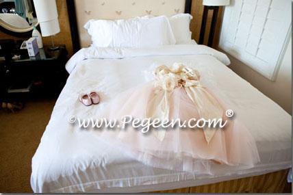 Pink flower girl dress on Bed